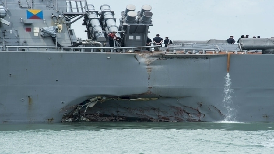 Damage to the USS John S McCain from a collision near Singapore with the Alnic MC tanker