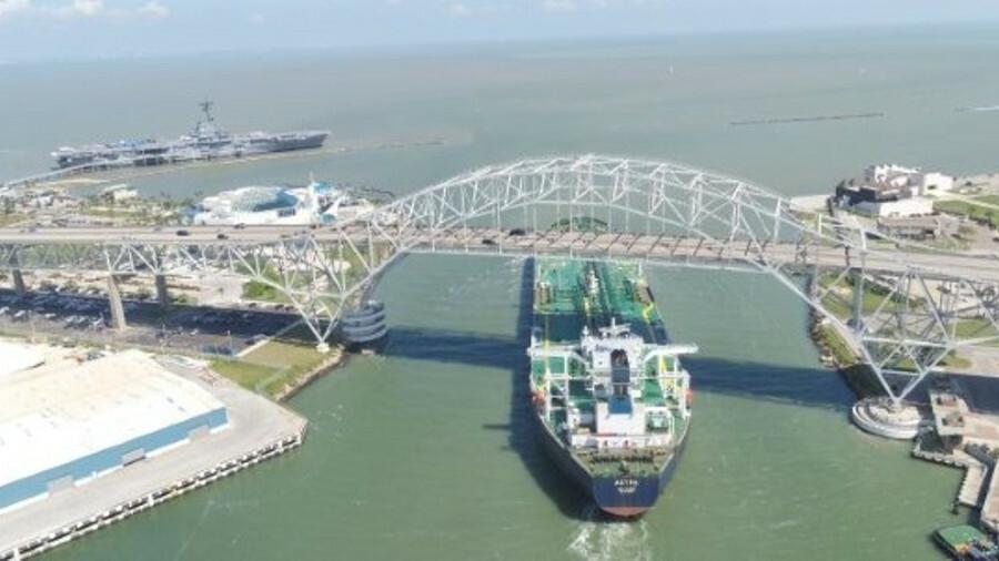 Astra sails under the Corpus Christi Harbor Bridge having loaded the first 1M barrel cargo of crude
