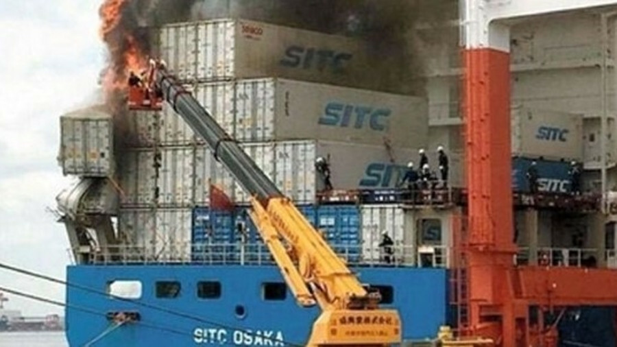 Firefighters tackle a fire on container ship SITC Osaka in Kobe, Japan