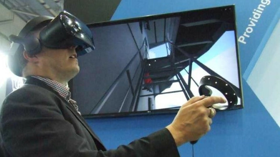 Martyn Wingrove uses the handheld device to interact with the VR program (credit Riviera Maritime Me