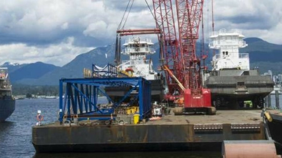 ITB's two new ATB tugs are loaded on a transport barge on the Fraser River