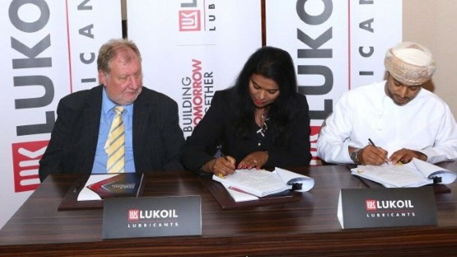 Lukoil director of marine lubricants June Manoharan signs the contract with Oman Shipping Company te