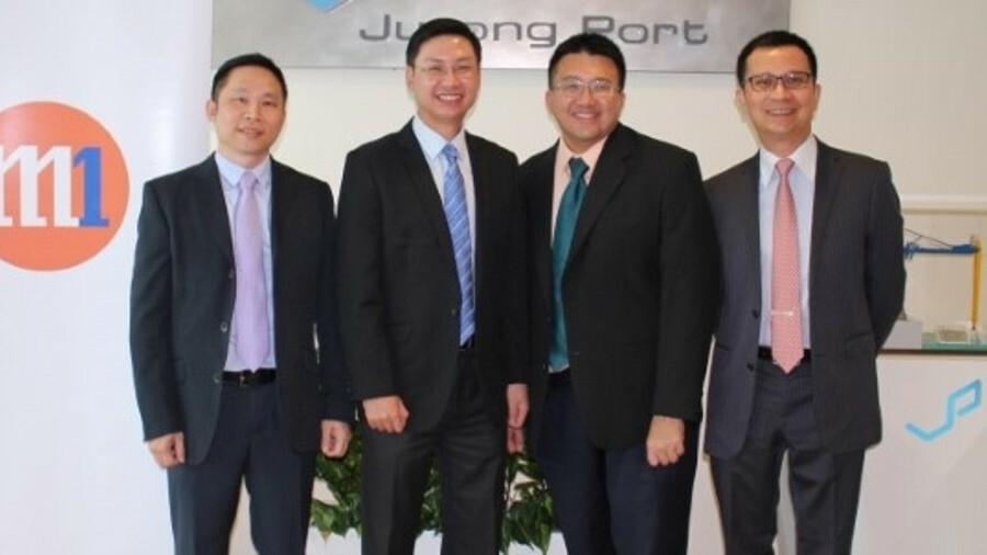 L-R: Sam Wei Hoong (Jurong Port), Desmond Lim (Jurong Port), Willis Sim (M1) , Denis Seek (M1) (cred