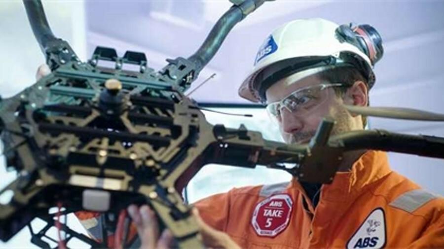 An ABS engineer prepares an aerial drone to begin a ship survey