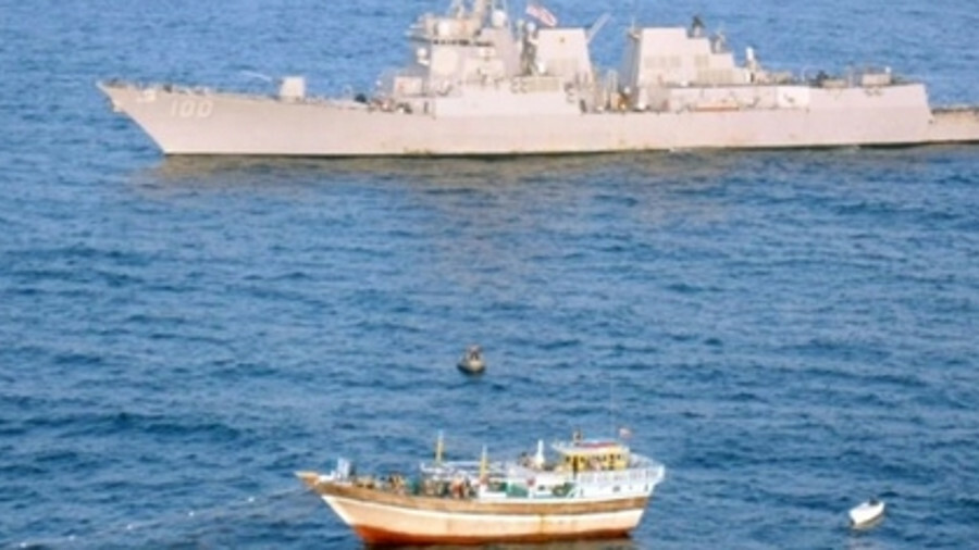USS Kidd rescuing an Iranian Dhow from pirates in 2012 (source: wikimedia commons)