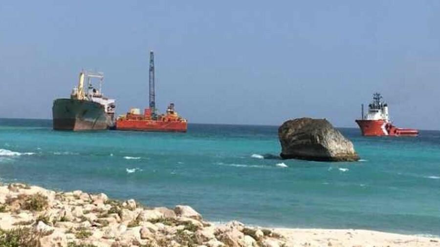 Resolve tug and crane barge salvaged bulk cement carrier Raysut II off Al-Fazayah Beach, Oman