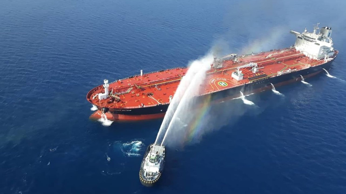 A fire boat assists a tanker attacked in the Middle East gulf