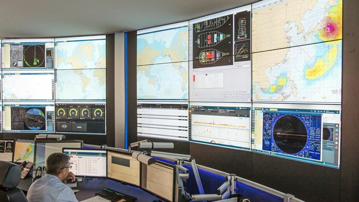Operators monitor and support cruise ships in Carnival's fleet operations centre