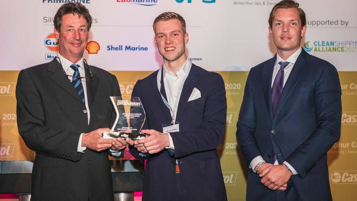 Kotug's Koos Smoor and Bert Jan Wilgen collect the award from Yara's Benjamen Pettersson (right)