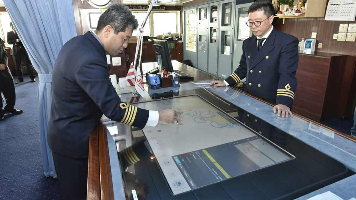 Officer on NYK ship bridge uses J-Marine NeCST navigation support tool