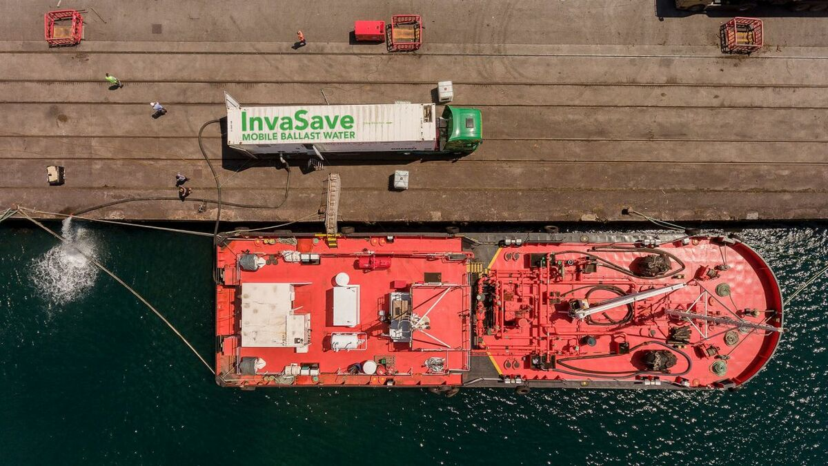 A tanker using an in-port solution to treat ballast water to IMO D-2 compliance