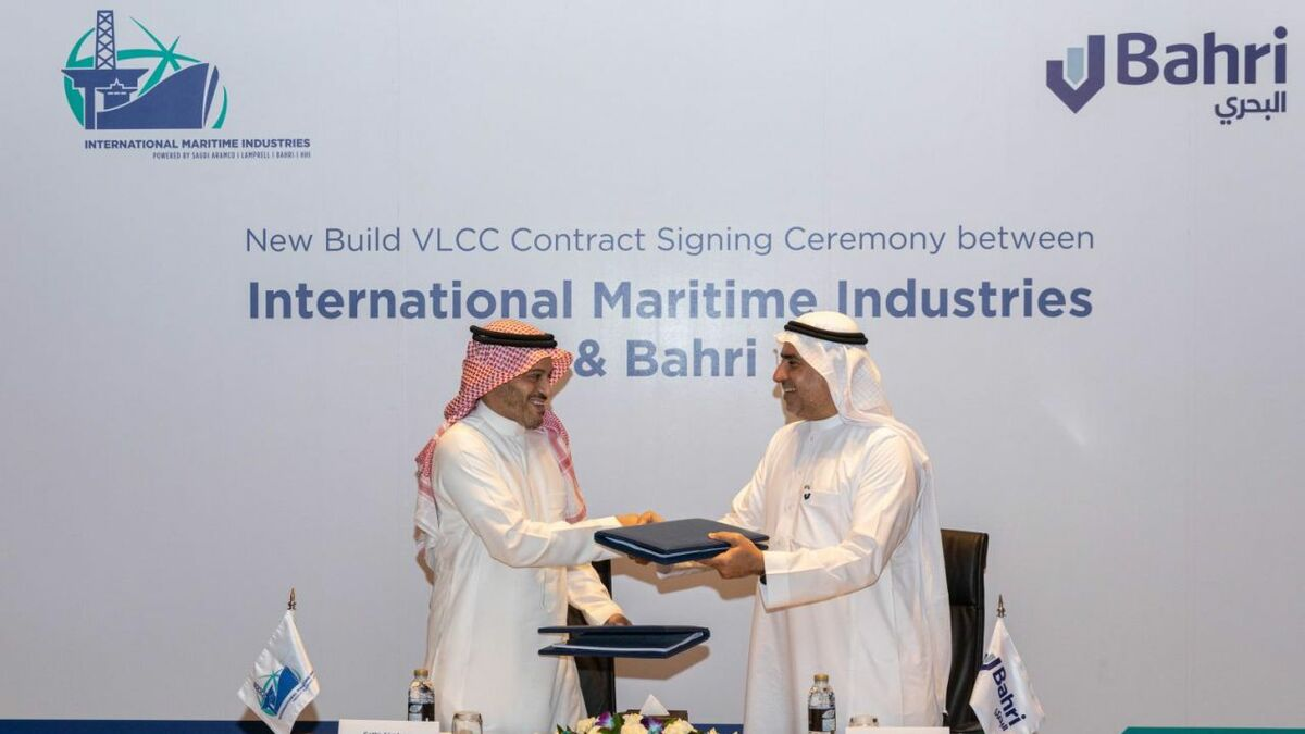 IMI CEO Fathi K Al-Saleem and Bahri CEO Abdullah Aldubaikhi sign the agreetment