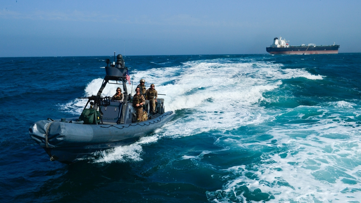 US Navy crew returns from a simulated mission to recover a hijacked tanker (photo Sgt Timothy Lawn)
