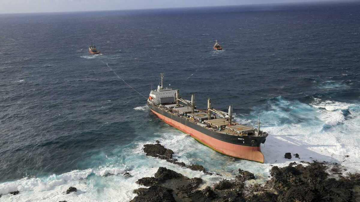 Salvage tugs refloat a cargo ship from rocks, reducing losses and protecting the environment