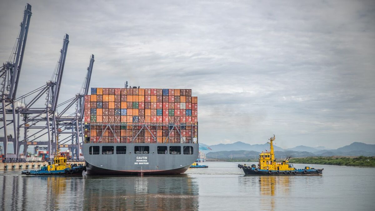 SAAM tugs assist a container ship into one of its own terminals in South America