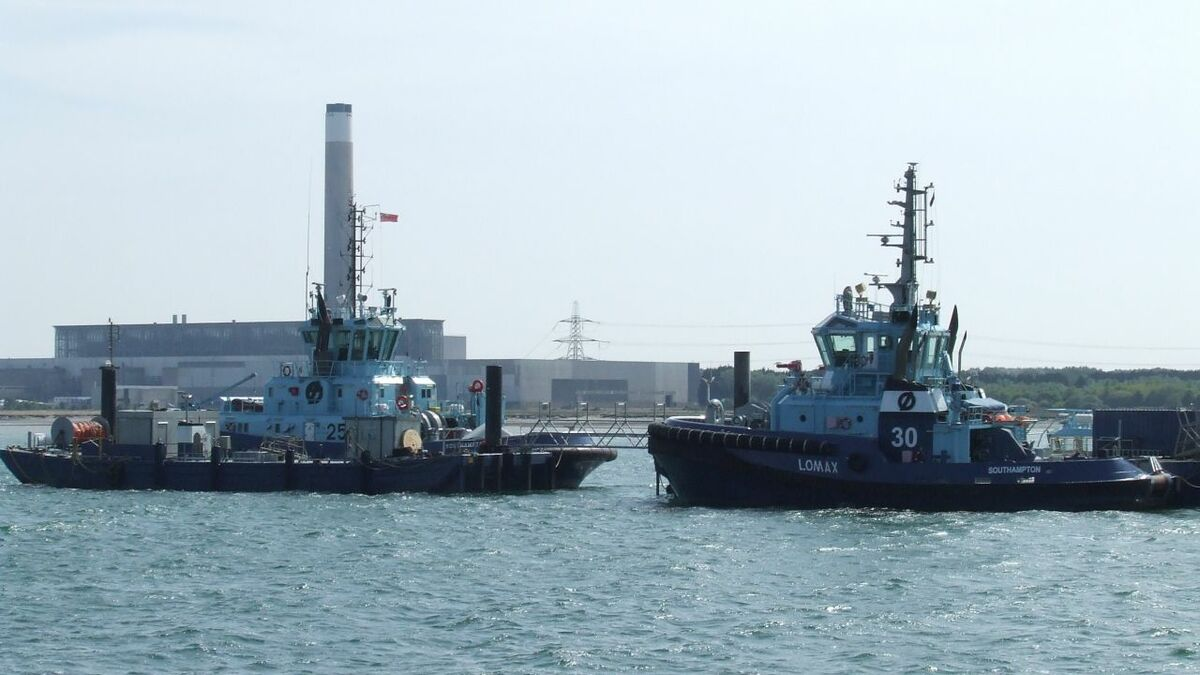 Environmental challenges ahead: tugs at Southampton's oil terminal and the power station behind