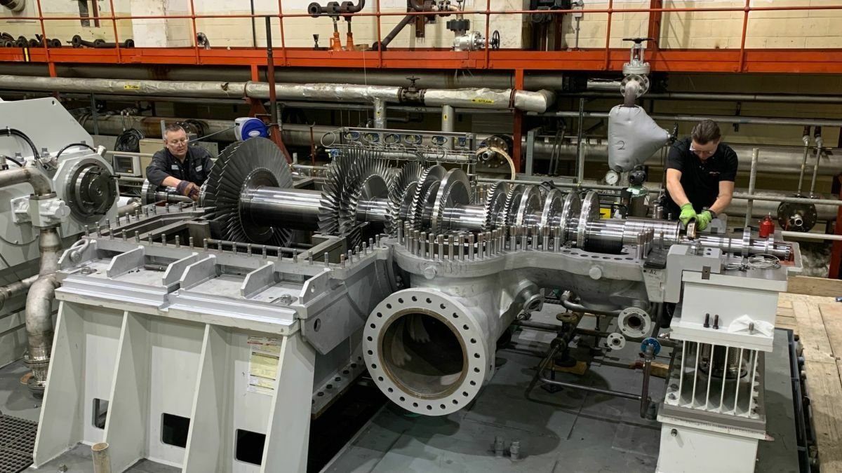Peter Brotherhood engineers aligning the rotor of a 26-MW extraction condensing steam turbine