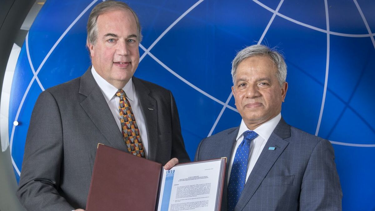 (l-r) Matt Desch (Iridium) receives GMDSS letter of compliance from Moin Ahmed (IMSO)