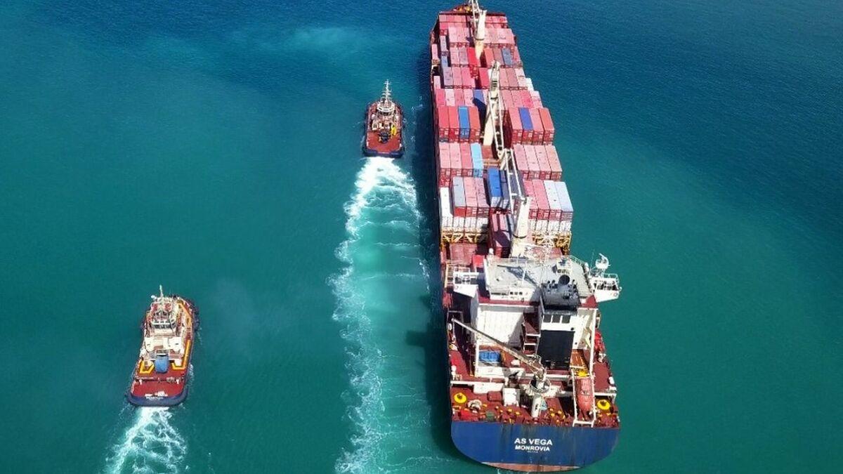 Equimar tugboats assist a container ship in Puerto Progreso Yucatan, Mexico