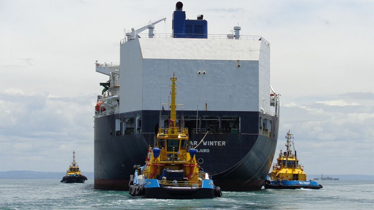 SAAM Towage tugs manoeuvres a ship into a terminal in South America