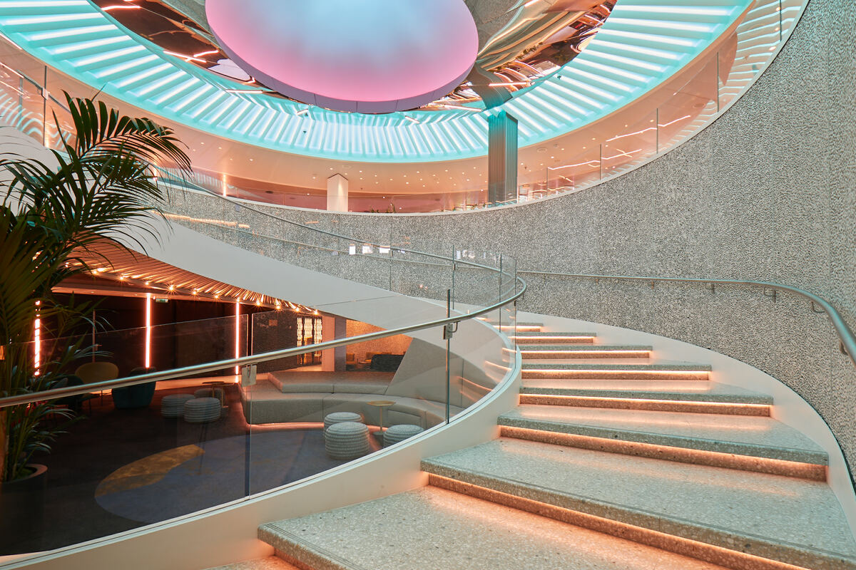 The theme of 'modern romance of sailing' lies behind the interior design of the ship (pictured, the Roundabout. Credit: Virgin Voyages)