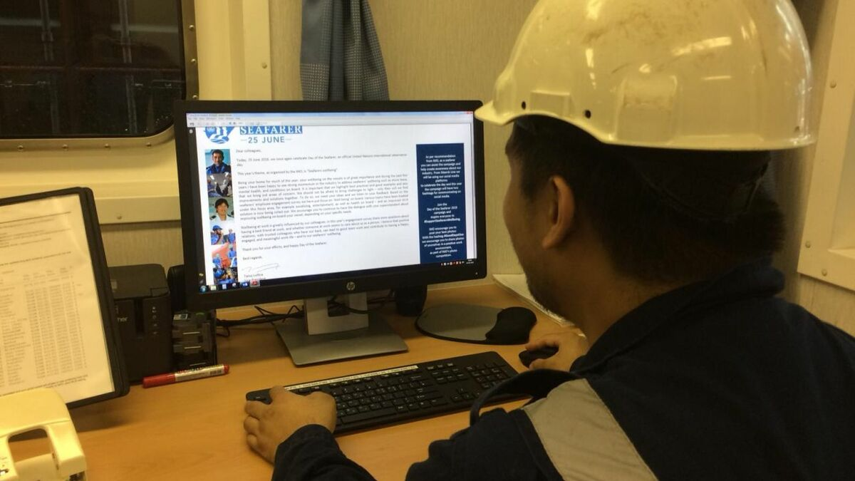 A seafarer views information on a computer for training (source: IMO)