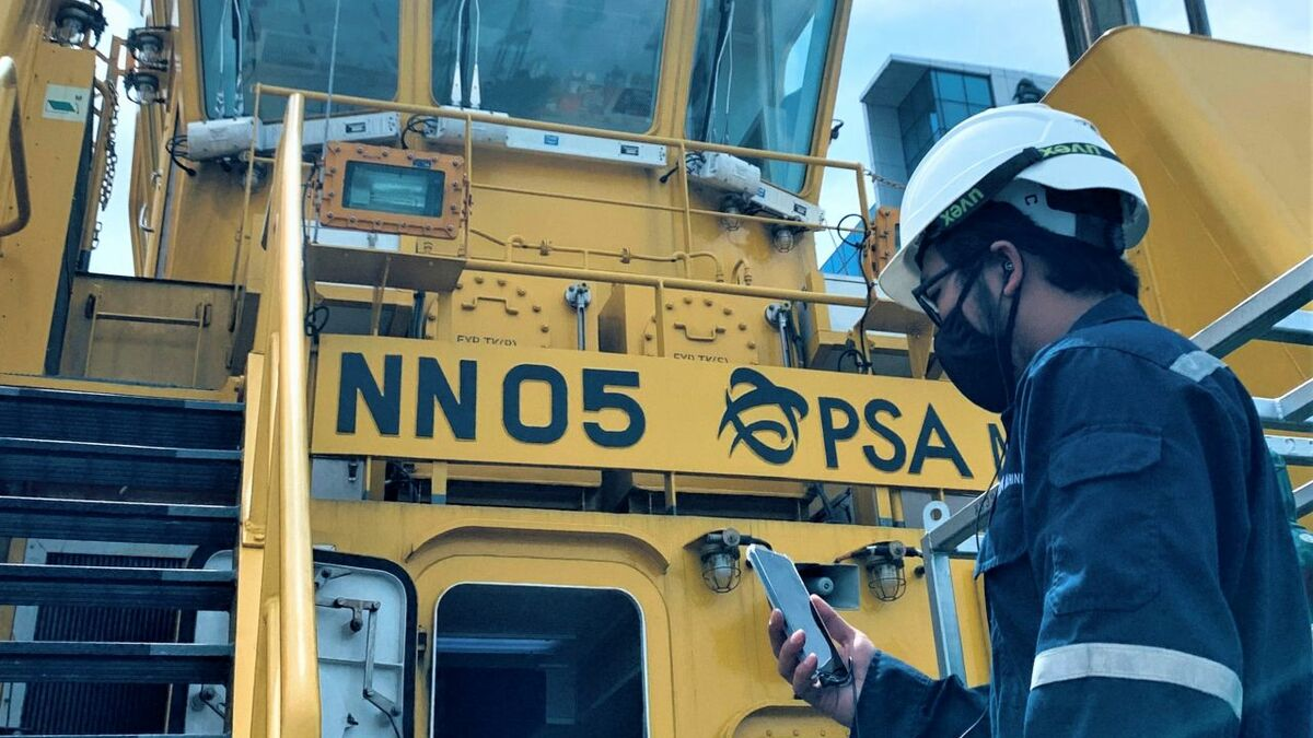 PSA Marine engineering officer updates a BV surveyor over a smart mobile device