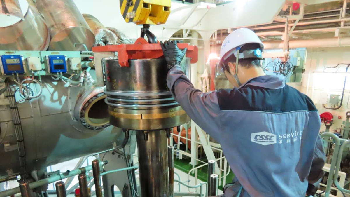 CSSC Marine Service technician examines piston for overhaul of SK Audace's X-DF engines