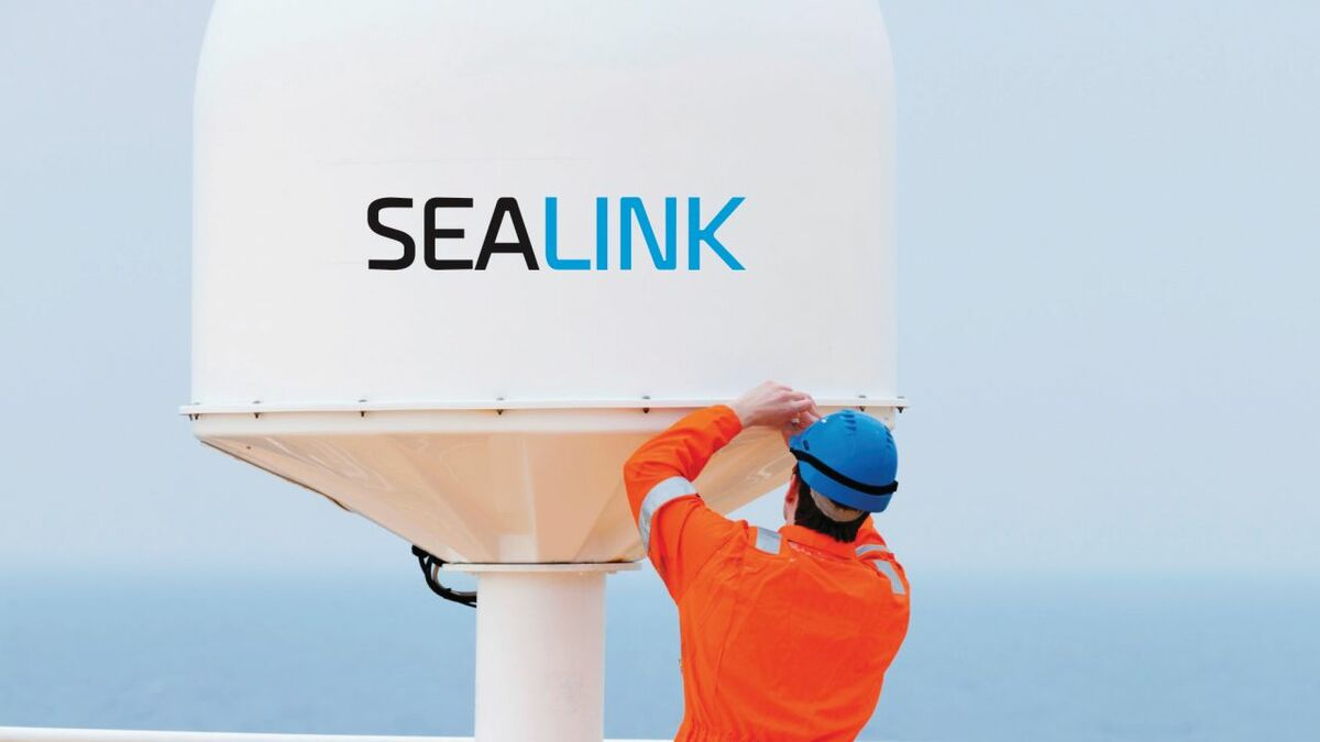 A Marlink engineer fits a Sealink VSAT antenna (source: Marlink)
