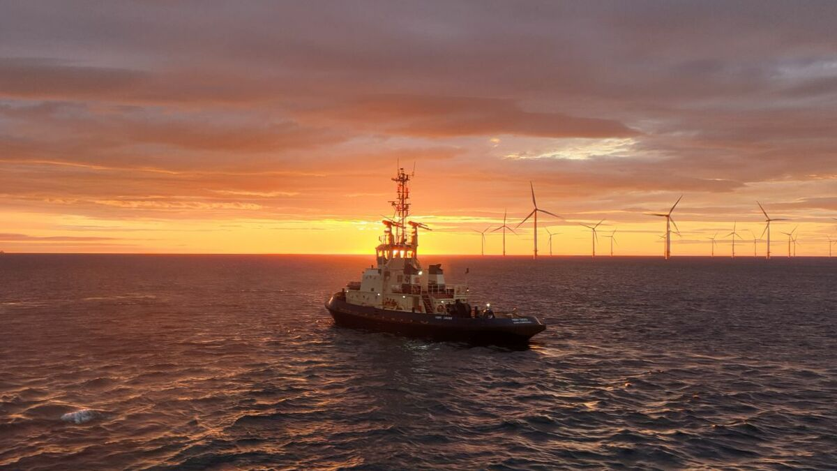 Sunrise over Tees - Svitzer tug and an offshore windfarm (source: Svitzer)