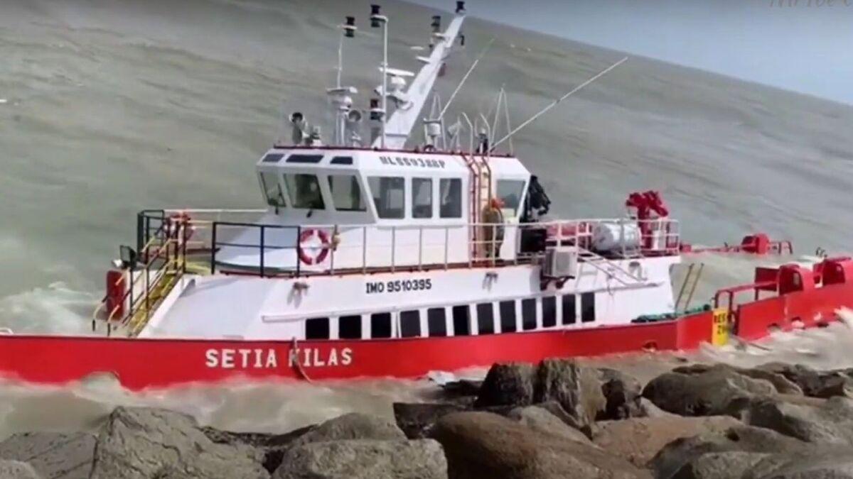 Setia Kilas on rocks at Kuala Terengganu port in Malaysia