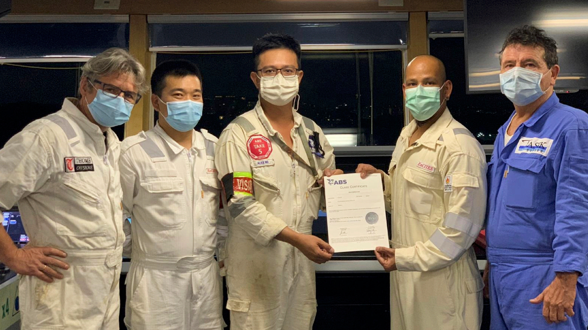 Form left to right: Southern Star chief engineer Dariusz Bartnicki, ship manager Yongtao Sun, ABS surveyor Alex Ng, master Captain Shangkar Kumar and Tasik Subsea superintendent Martin McGrath with the new class certificate (source: Tasik Subsea)