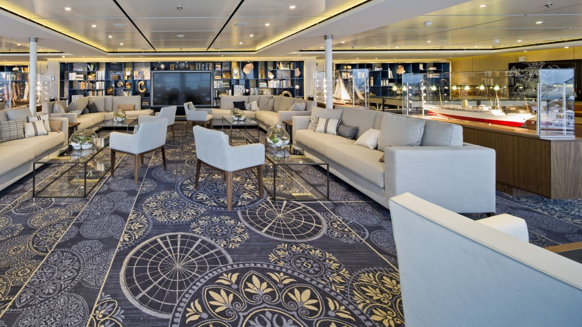 With two-story panoramic windows, the Explorers' Lounge offers unparalleled views of the sea and scenery (source: Viking Cruises)