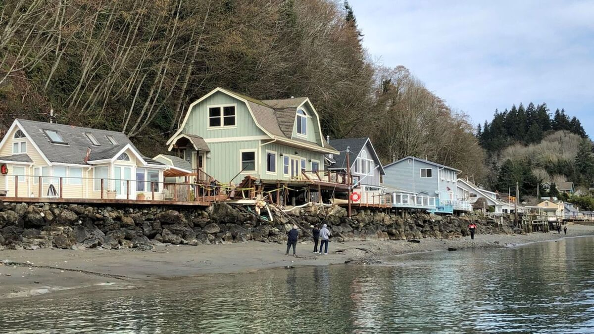Onlookers observe the damage caused by a barge collision near Gig Harbor (source: USCG)