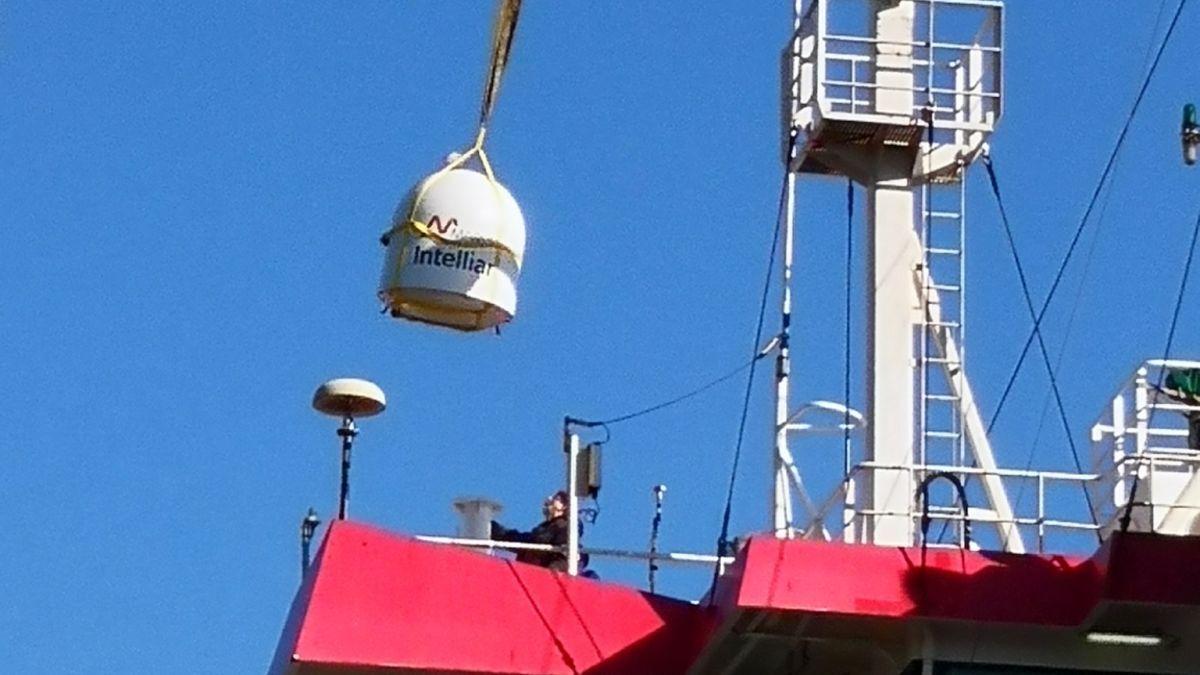 A crane installs Marlink VSAT on a Held ship bridge (source: Held)