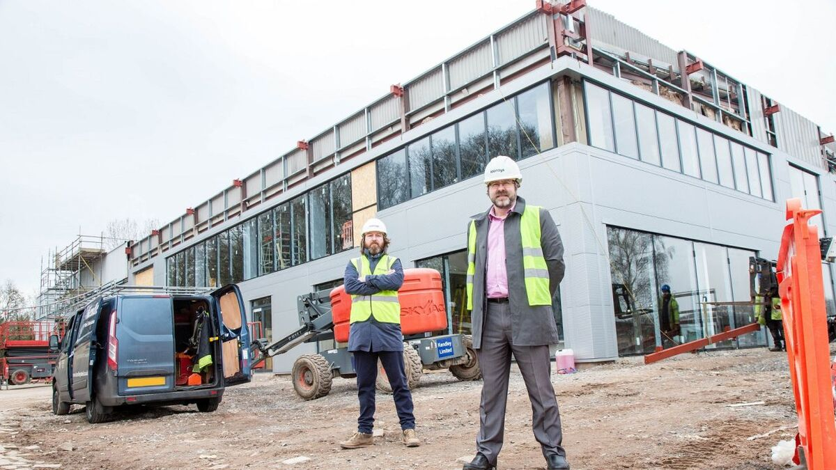 (L-R) iconsys Nick Darrall and Tim Munn outside new HQ construction (source: iconsys)