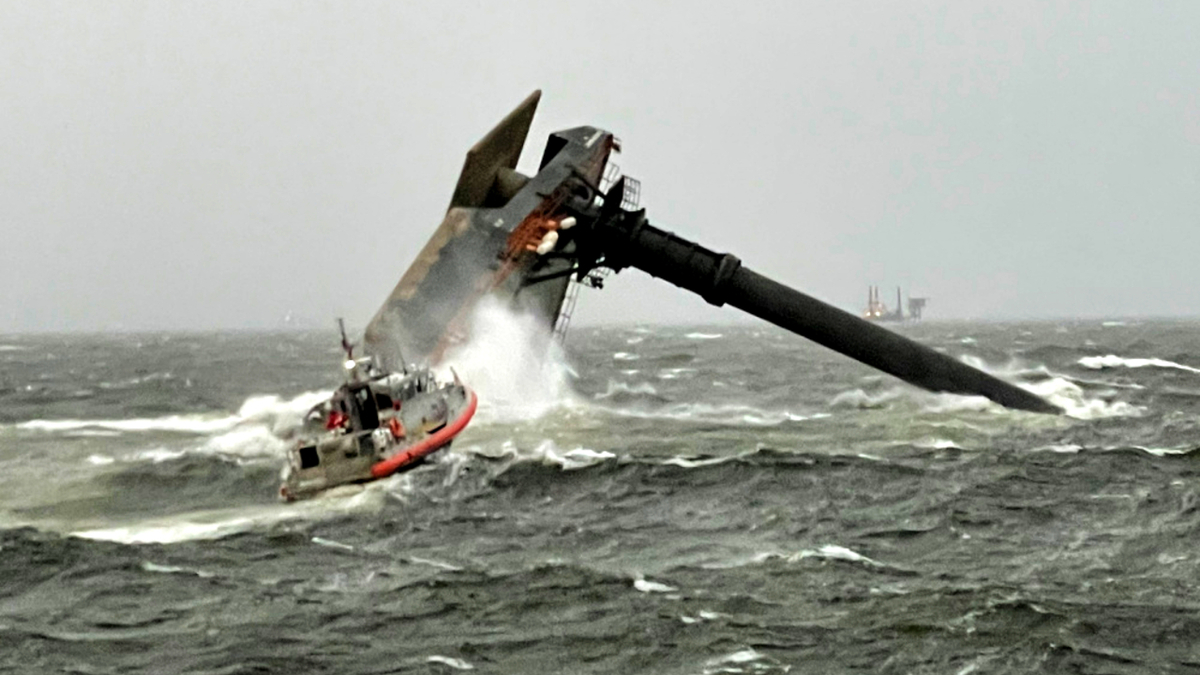 A USCG response boat speeds to the aid of a capsized lift boat in the US Gulf of Mexico (source: USCG)
