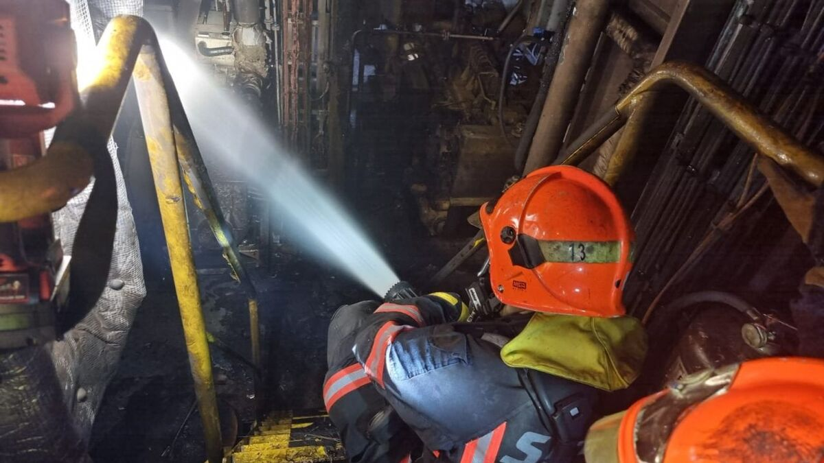 Fire fighters tackle an engineroom blaze on a PSA Marine tug (source: SCDF)